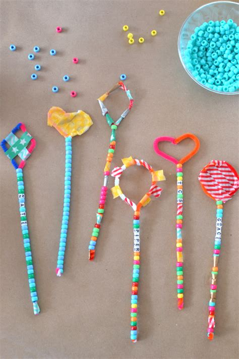 kid crafts pipe cleaner wands at the craft fair artbar