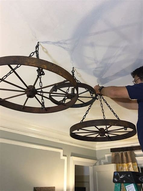 Wagon Wheel Ceiling Light by Hang Wagon Wheels From Your Ceiling Wagon Wheel