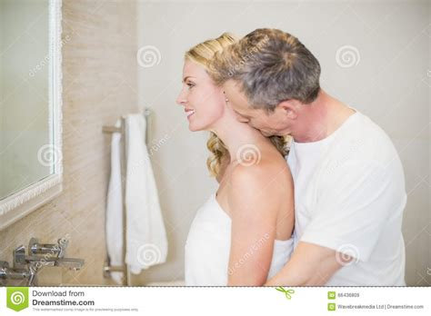 with wife in bathroom husband kissing wife on the neck stock photo image 66436809
