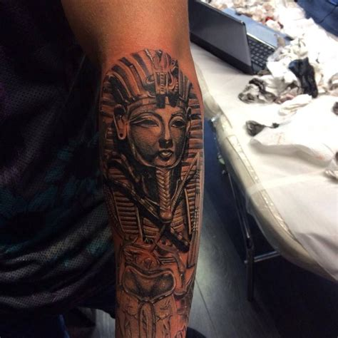 king tut tattoos tutankhamun and scarab as part of an