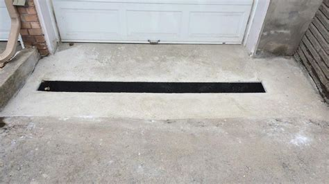 Garage Drainage by Garage Entrance Drainage Construction Project 16