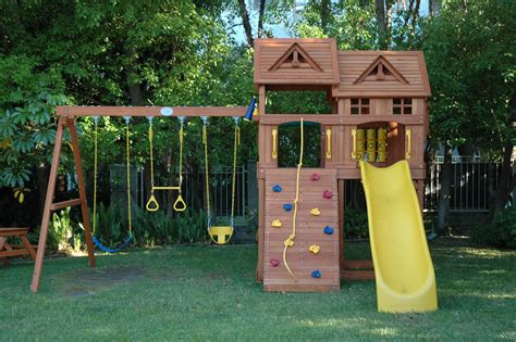 wooden playhouse with swing fun and entertaining outdoor playhouse for children design