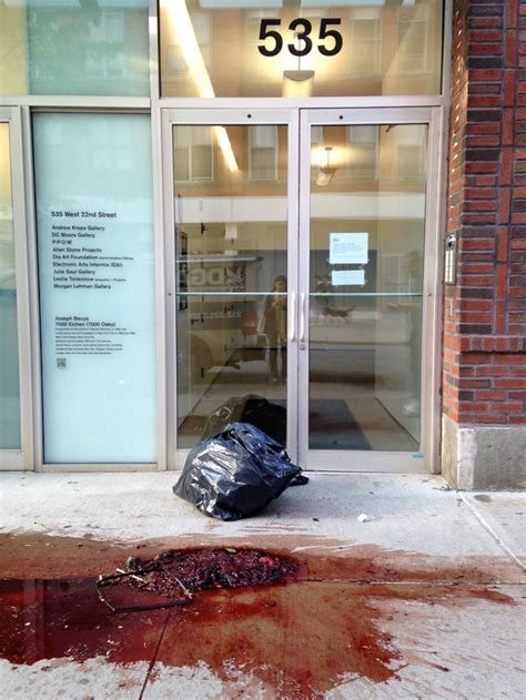 Decorating Program artists protest carl andre retrospective with blood