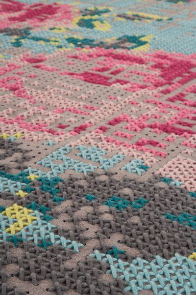 rugs and cross stitch on