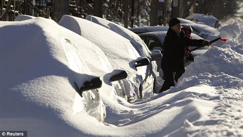 blizzard of agressive cars in montreal buried like snowy marshmallows as winter