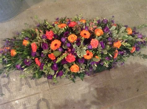Orange Floral King Sprei orange gerbera orange carnation purple lisianthus coffin spray funeral flower spray www