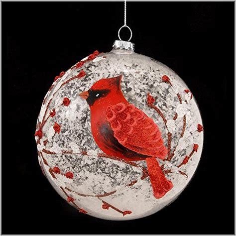 snowy red cardinal branches glass ball christmas tree