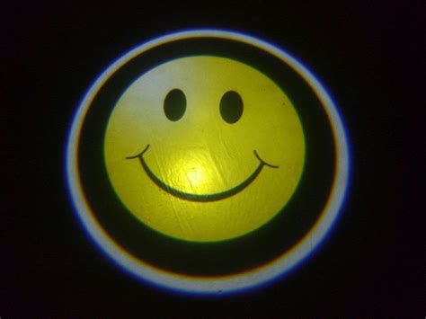 projector lights smiley door projector courtesy puddle logo light