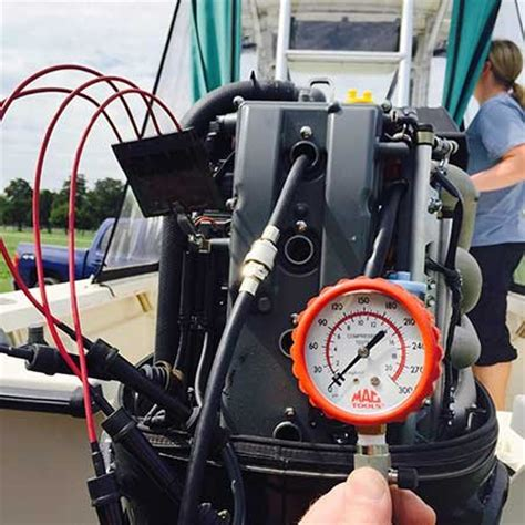 boat engine compression test checking compression on an outboard engine boatus magazine