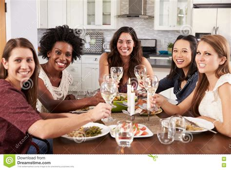 party at home group of female friends enjoying dinner party at home