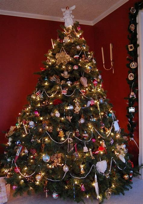 vicorian christmas trees were covered with beads and hand