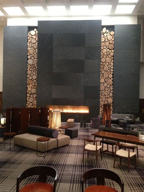 hotel with fireplace wood wall feature kustlijn interior