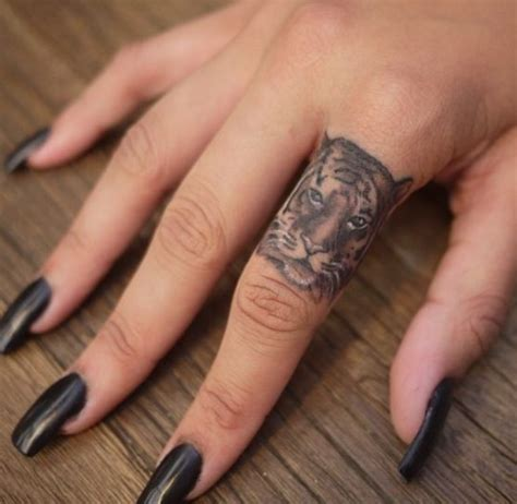 tiger finger tattoo grey ink tiger finger