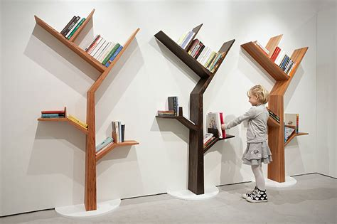 a bookcase shaped like a tree by kostas design