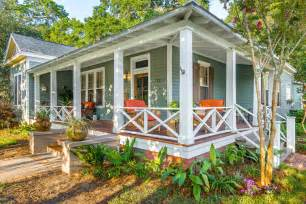 wrap around front porch farmhouse porch porch traditional with wooden entry door