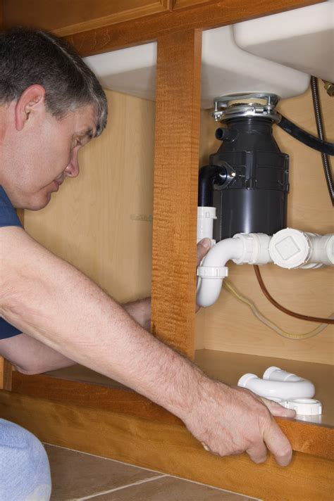 garbage disposal backing up into how to stop disposal from backing up into other