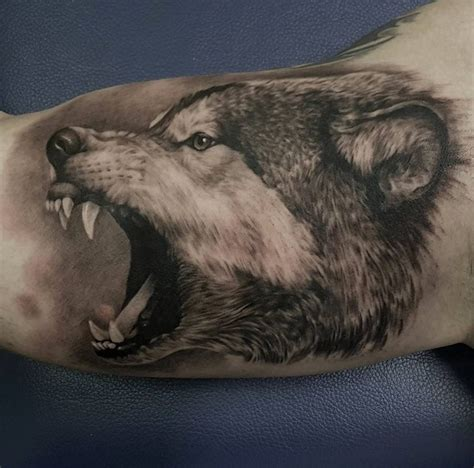 angry wolf tattoo grey ink angry wolf on bicep by casper tattoos