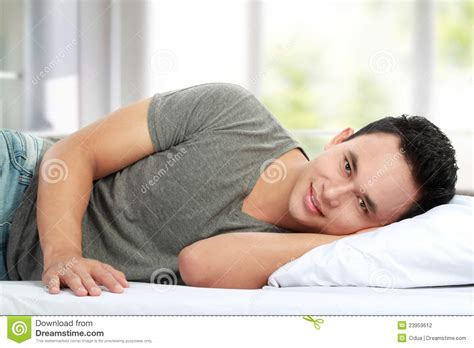 lying in my bed man lying in bed smiling stock photography image 23959612