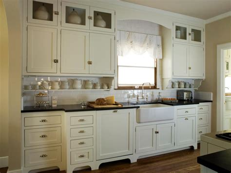 This Quaint Cottage Kitchen Features Antique White Shaker Black Shaker Kitchen Cabinets