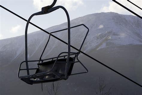 an empty chair lift at a ski resort by tim laman