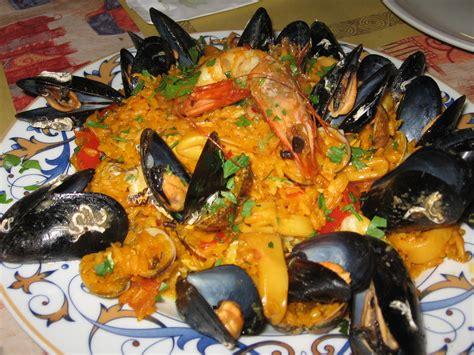 cucinare la paella di pesce ricette salate paella di pesce notizie it