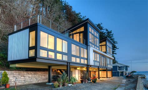 design of hill house future proof beach residence in washington state is raised