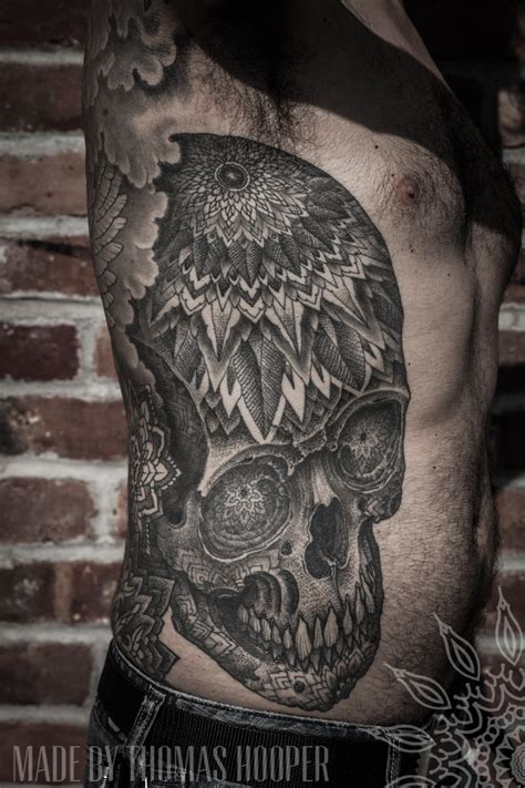 thomas hooper tattoo hooper tibetan skull ribs abstract symbols dotwork