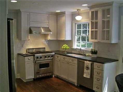 white kitchen cabinets with black countertops antique white cabinets with granite white kitchen