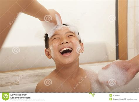 girl in bathroom with boy young boy in bubble bath stock photo image 36762960