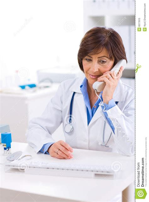 doctor the phone doctor calling on phone stock image image of friendly