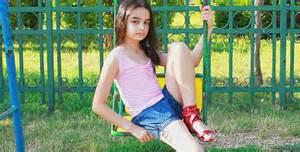 Sad young girl on swing 1 by marianvideo videohive