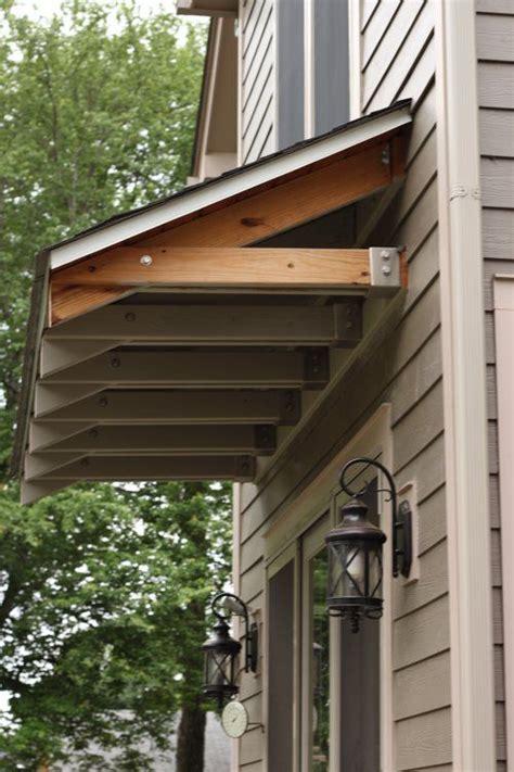 garage door overhangs   build awning  door