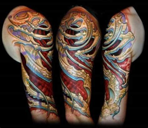 Biomechanical Tattoo Guy Aitchison | colorful biomechanical tattoo by guy aitchison design of