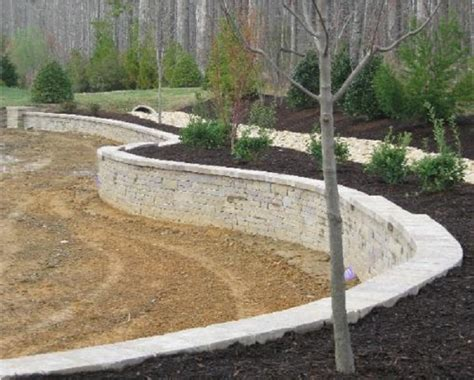 how to flatten backyard retaining walls richmond va wall installation seating