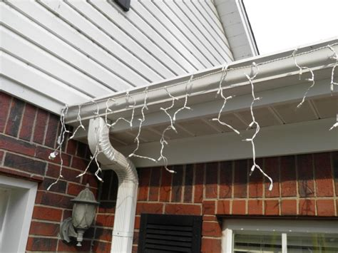 hanging christmas lights on gutters with mesh leaf guard