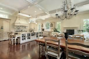 White kitchen dark wood wood floors and elevated white beamed ceiling