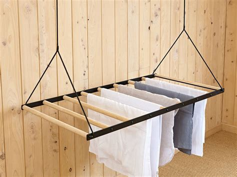 this hanging clothes drying rack can be raised and lowered