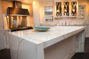white kitchen island with top vicostone calacatta quartz