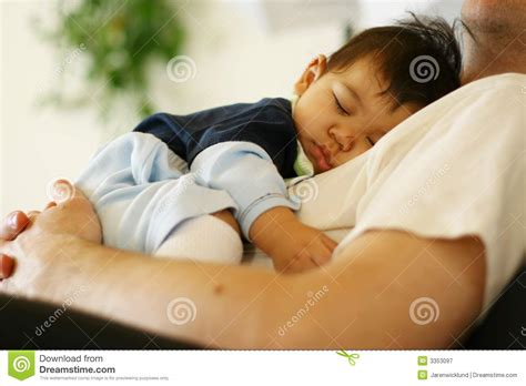 sleeping with baby in recliner baby sleeping on dad s chest royalty free stock