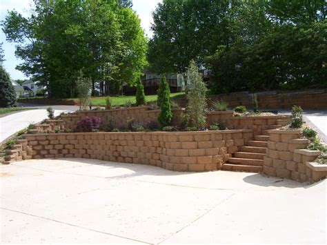 two tier retaining wall with steps and flower beds yelp