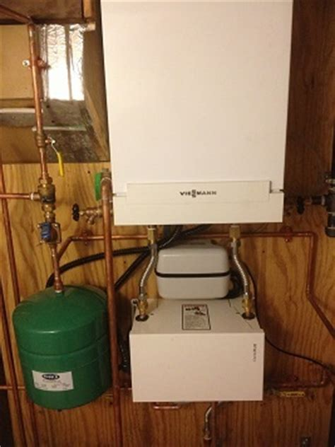 Kaufman Plumbing by Boiler Replacement With On Demand Water Heater