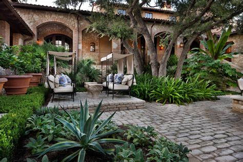 Outside The Gates Of The World Hardy cobblestone pavers exterior mediterranean with circular