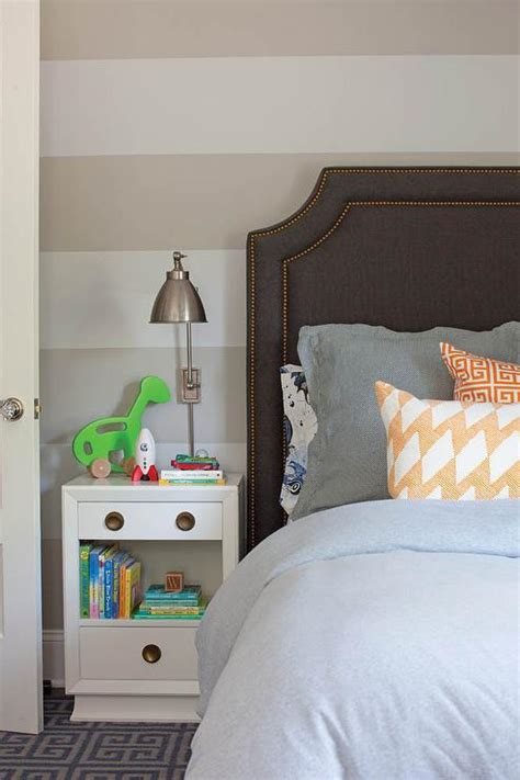 gray kids headboard with blue stripe bedding boys bedroom with white and beige striped walls