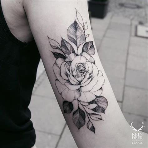 rose tattoo on arm black and white usual blackwork style zihwa typical arm tattoo of big rose