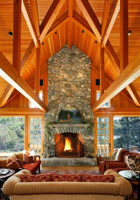river rock room tournaments timberframe trusses with river rock fireplace open walls of windows doors house