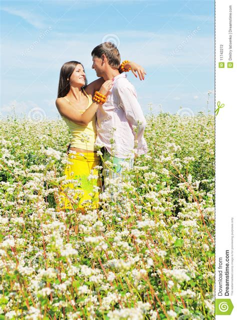 Cauple Senny on field of flowers stock photo image 11742272