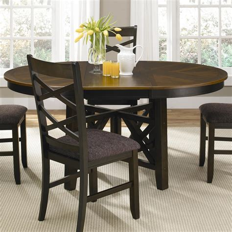 dining room table with butterfly leaf liberty furniture bistro ii round to oval single pedestal