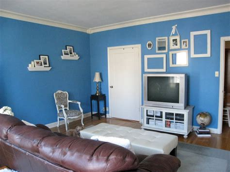 blue wall paint colors for small living room decorating ideas with brown leather sofa and wood