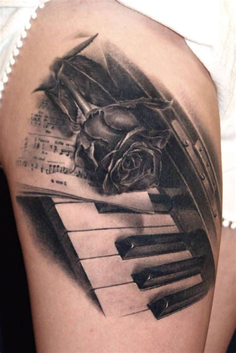 rose with key tattoo with amazing piano design idea