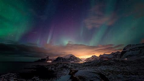 ocean mountains night northern lights beach sea stars sky